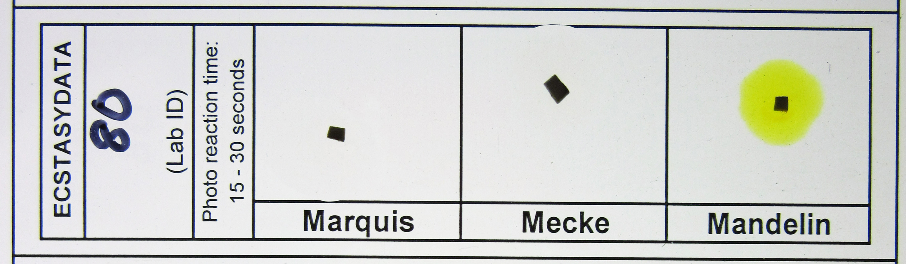 "Figure 2 LSD sample confirmed by GC/MS produces no response to Marquis, Mecke, or Mandelin reagents.  Black squares shown to illustrate blotter location do not indicate a ""black"" color reaction to these tests."